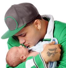 Young father holding his baby close